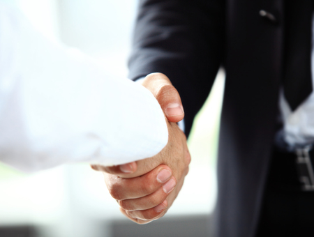 team success: Business people shaking hands, finishing up a meeting Stock Photo