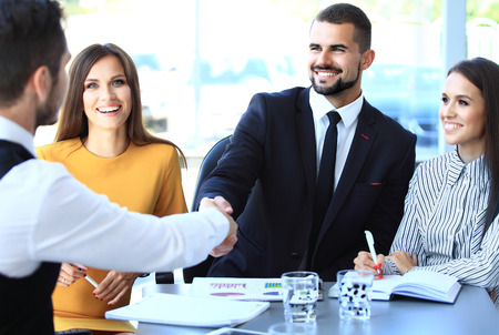 team leader: Business people shaking hands, finishing up a meeting Stock Photo