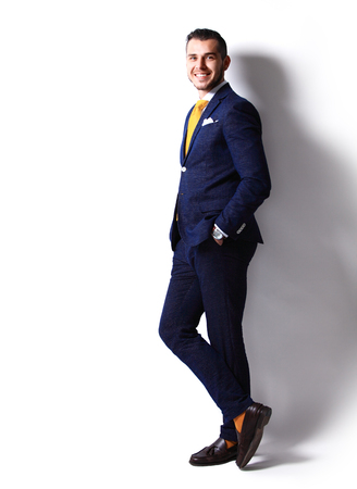 uomo felice: Full body portrait of young happy smiling cheerful business man Archivio Fotografico