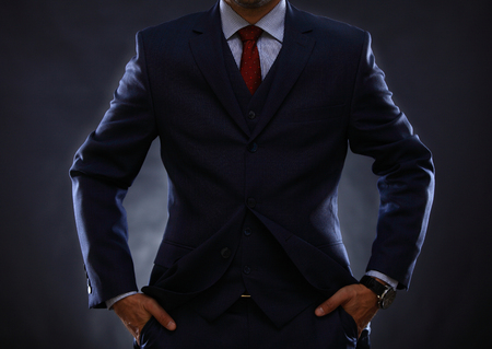 man in the suit on black