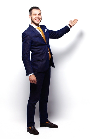 Happy Young Businessman Presenting Isolated Over White Background