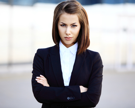 young executives: Portrait of a successful business woman smiling. Beautiful young female executive in an urban setting