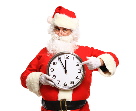 to santa: Happy Santa in eyeglasses pointing at clock showing five minutes to Christmas