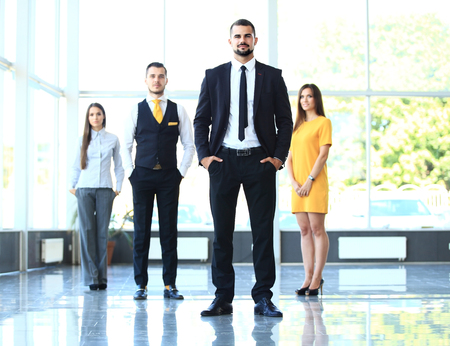 confidently: Group portrait of a professional business team looking confidently at camera