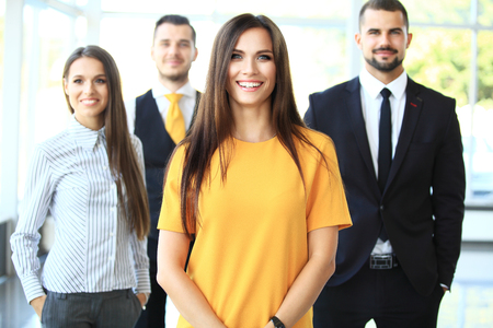 Successful business team smiling at the office Stock Photo - 48074233