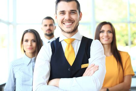 mujeres juntas: Businessman with colleagues in the background