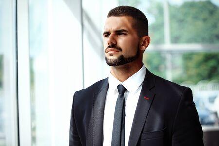man looking: Handsome smiling confident businessman portrait Stock Photo