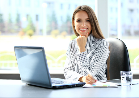 business executive: Business woman working on laptop computer at office