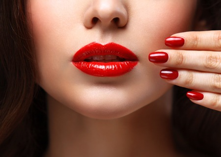 manicure salon: Red Sexy Lips and Nails closeup. Stock Photo