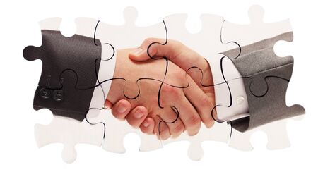 shaking hands inside puzzle pieces isolated on white