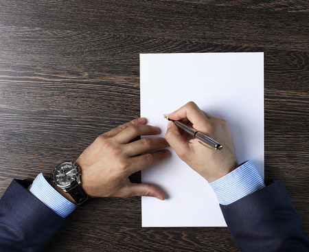 white people: Close-up of male hands with pen over document
