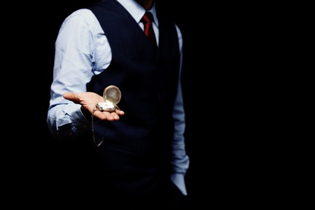 mans watch: mans hand with a watch isolated on black