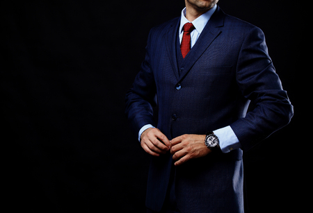 man in suit on a black background Banco de Imagens - 50162916