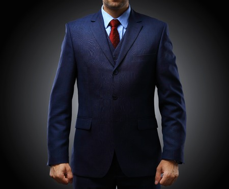 man in suit: man in suit on a black background