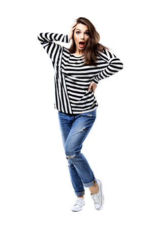 Full body portrait of surprising woman. White background.