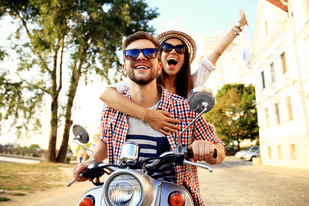 transportation travel: Couple in love riding a motorbike
