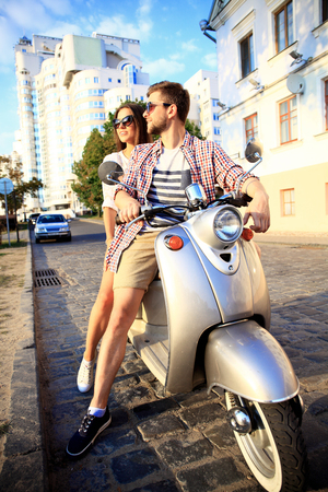 holiday trip: Couple in love riding a motorbike , Handsome guy and young sexy woman travel . Young riders  enjoying themselves on trip. Adventure and vacations concept.