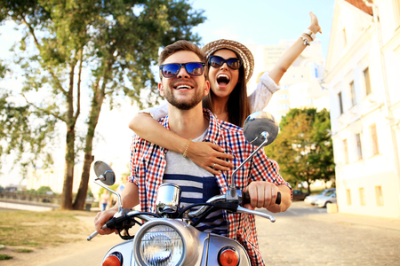 Couple in love riding a motorbike