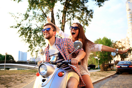 Couple in love riding a motorbike Banco de Imagens - 53536756