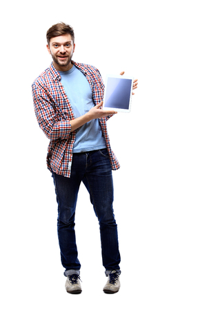 25 29 years: Man holding a tablet computer against a white background Stock Photo