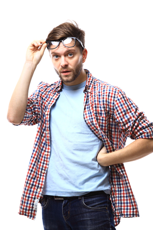 unexpectedness: portrait of young surprised man in glasses