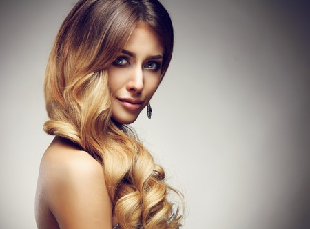 glamour hair: Beautiful blonde woman with long, healthy , straight and shiny hair. Hairstyle loose hair