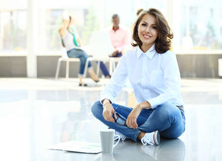 beautiful face woman: Face of beautiful woman on the background of business people