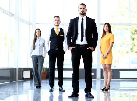 business lifestyle: Group portrait of a professional business team looking confidently at camera