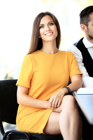 successful woman: Face of beautiful woman on the background of business people