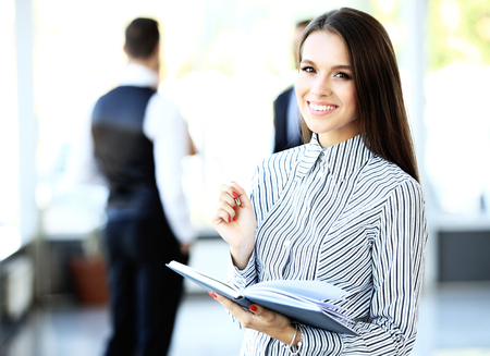 happy workers: Face of beautiful woman on the background of business people