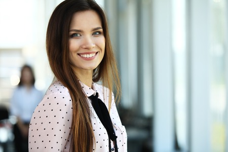 attractive woman: Face of beautiful woman on the background of business people