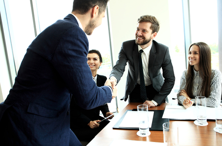 deal: Business people shaking hands, finishing up a meeting Stock Photo