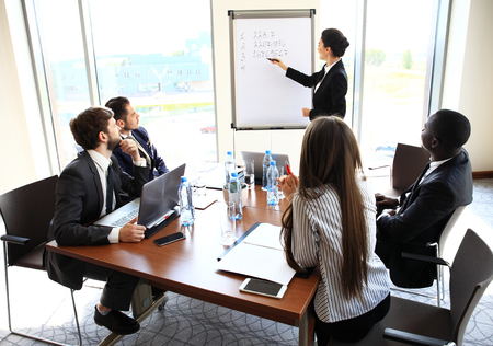businessgroup: Woman making a business presentation to a group