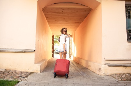 suitcases: Young girl with a suitcase. Vacation concept