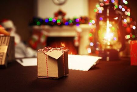 fortunately: Gifts under the Christmas tree lights background