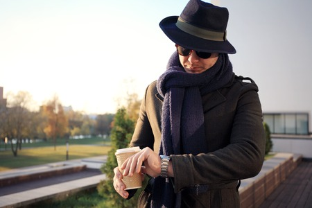Trendy handsome young man in autumn fashion standing in urban environment Reklamní fotografie