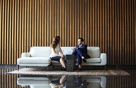 Businessman And Businesswoman Meeting In Modern Office. photo
