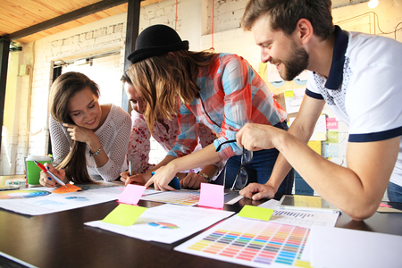 shared: group of young business people , Startup entrepreneurs working on their venture in coworking space. Stock Photo