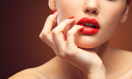 Red Sexy Lips and Nails closeup. Open Mouth. Manicure and Makeup. Make up concept. Standard-Bild