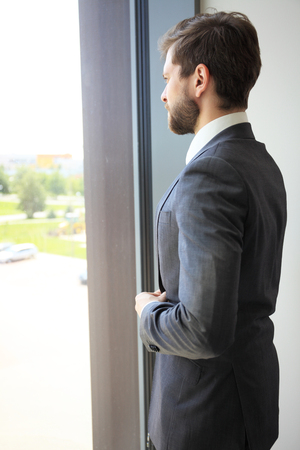 Portrait of a businessman looking at the window. photo