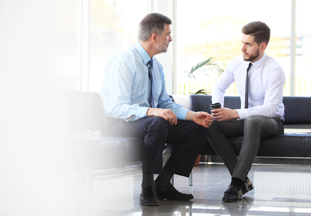 Two business colleagues at meeting in modern office interior.