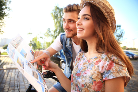 Young loving couple planning their romantic adventure. Joyful young couple smiling. Stock Photo