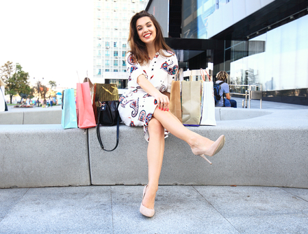 Happy woman holding shopping bags and smiling Stock Photo