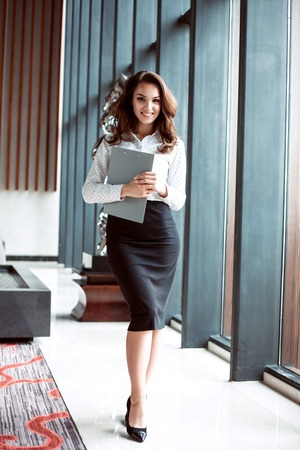 Modern business woman in the office with copy space.