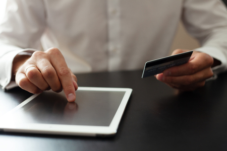 Man using Tablet pc. Credit card, Shopping online.