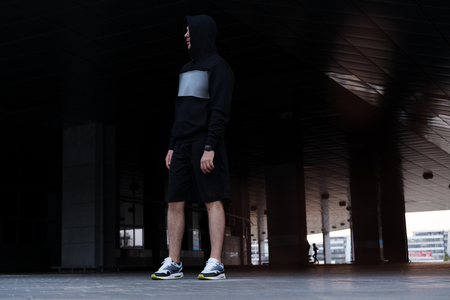 Urban man prepare to jogging in the city. Working out urban