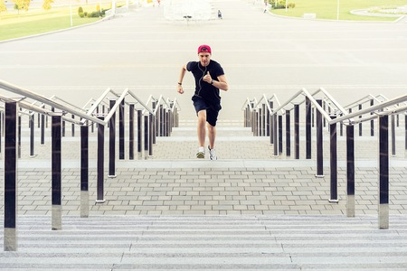 healthy lifestyle. Sporty Young Man Running Upstairs Outdoors