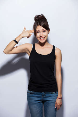 people, style and fashion concept - happy young woman or teen girl in casual clothes having fun.