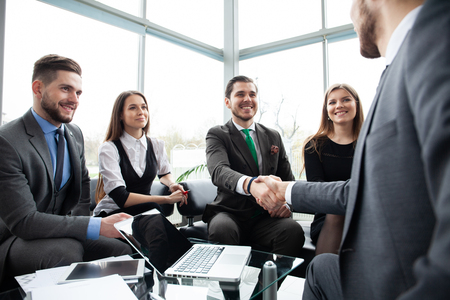 Business people shaking hands, finishing up a meeting. Handshake. Business concept. Stock Photo - 116122860