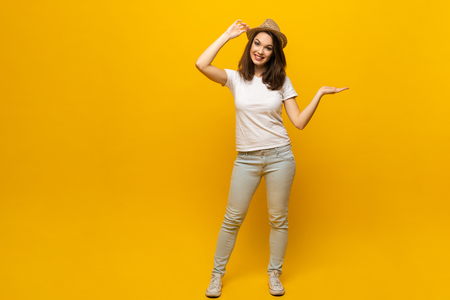 No way, look this ! Woman pointing finger at copy space. Expression emotion and feelings concept. Studio shot, isolated on yellow background. Stock Photo